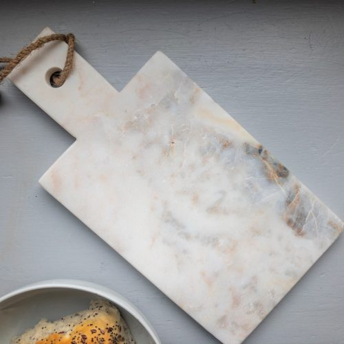 Marble chopping board with bread