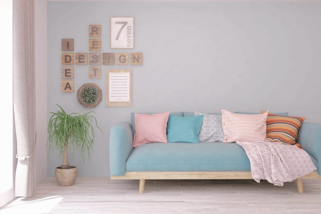 Blue sofa with lettering on the wall