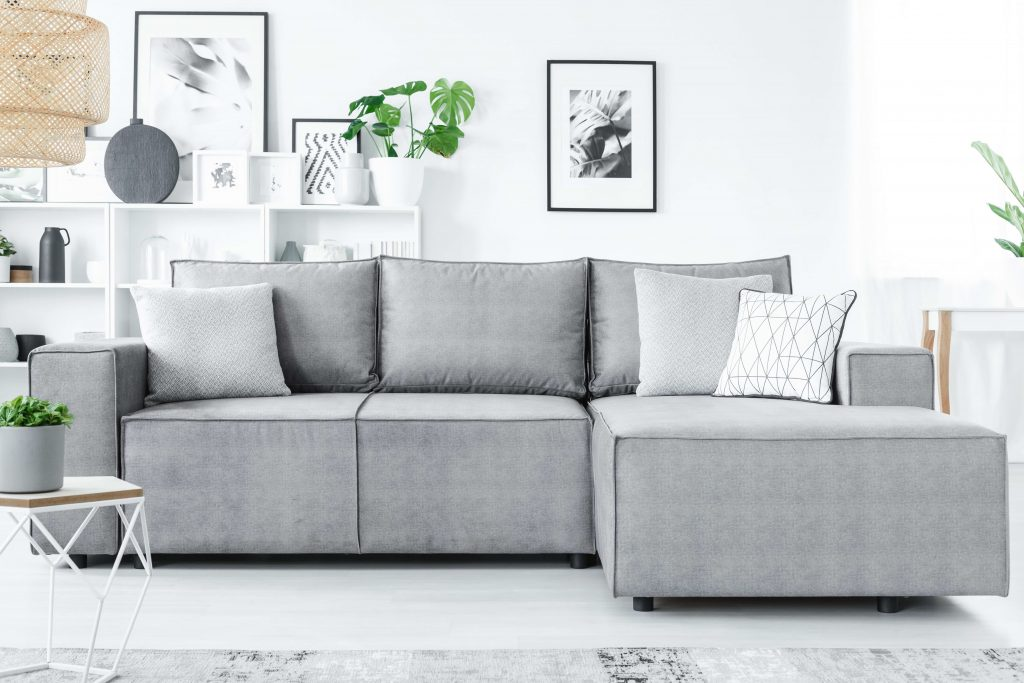Grey sofa with bookcase
