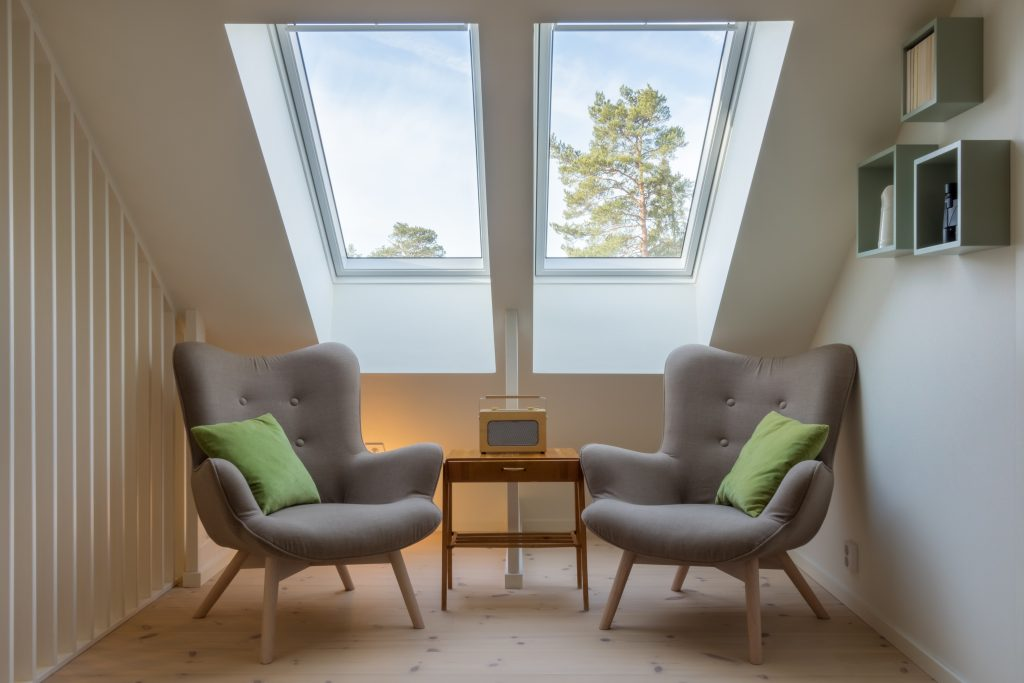 two reading chairs below skylights